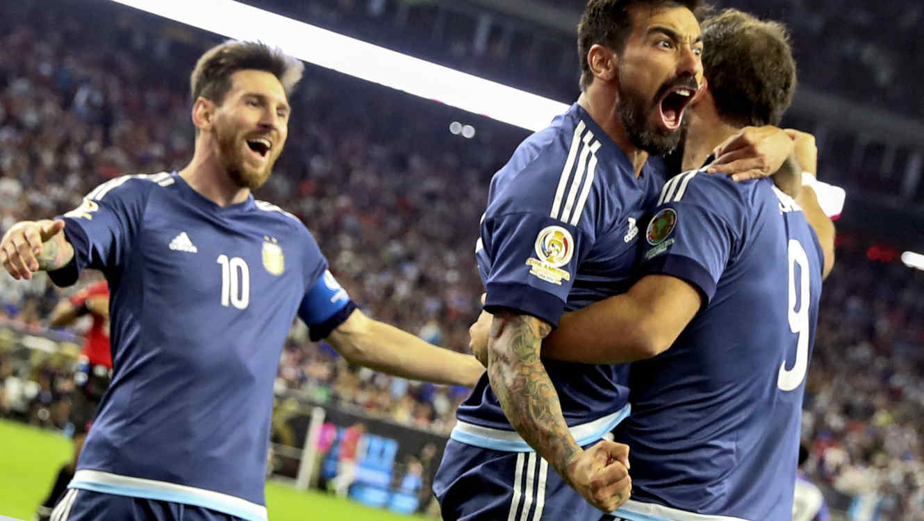 Jun 21, 2016; Houston, TX, USA; Argentina forward Gonzalo Higuain (right) celebrates with forward Ezequiel Lavezzi (middle) and  midfielder Lionel Messi (10) after scoring a goal during the second half against the United States in the semifinals of the 2016 Copa America Centenario soccer tournament at NRG Stadium. Mandatory Credit: Kevin Jairaj-USA TODAY Sports - RTX2HHXZ